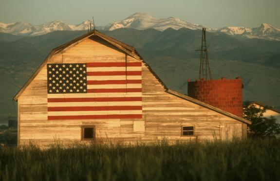 barn with flag painted on side